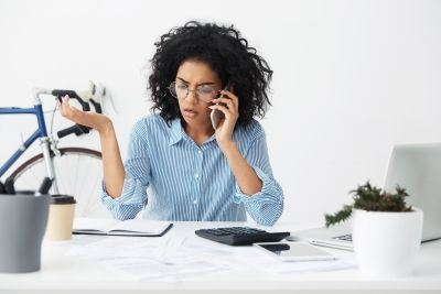 Upset Business Woman on a Cell Phone